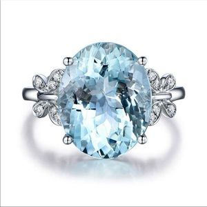 Oval shaped blue stone sparkling ring